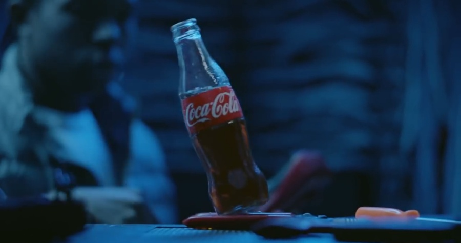 bottle of Coke spilling on internet wires